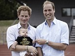 Hands full: Prince Harry and the Duke of Cambridge with a young Invictus Games supporter on Tuesday
