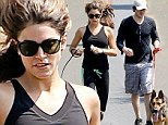She got custody of the dogs! Nikki Reed and new beau Ian Somerhalder jog alongside the German Shepherds she adopted with estranged husband