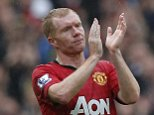 Manchester United's Paul Scholes applauds as he is substituted on home ground for the last time, during the English Premier League soccer match against Swansea City at Old Trafford stadium in Manchester, northern England on May 12, 2013.   Scholes will quit playing at the end of the Premier League season, the Manchester United midfielder said on Saturday.   REUTERS/Phil Noble (BRITAIN  - Tags: SPORT SOCCER) FOR EDITORIAL USE ONLY. NOT FOR SALE FOR MARKETING OR ADVERTISING CAMPAIGNS. EDITORIAL USE ONLY. NO USE WITH UNAUTHORIZED AUDIO, VIDEO, DATA, FIXTURE LISTS, CLUB/LEAGUE LOGOS OR 'LIVE' SERVICES. ONLINE IN-MATCH USE LIMITED TO 45 IMAGES, NO VIDEO EMULATION. NO USE IN BETTING, GAMES OR SINGLE CLUB/LEAGUE/PLAYER PUBLICATIONS.