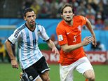 SAO PAULO, BRAZIL - JULY 9:  Maxi Rodriguez of Argentina and Daley Blind of the Netherlands in action during the 2014 FIFA World Cup Brazil Semi Final match between Netherlands and Argentina at Arena de Sao Paulo on July 9, 2014 in Sao Paulo, Brazil. (Photo by Jean Catuffe/Getty Images)