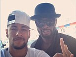 Bros: Neymar's selfie with Barcelona teammate Alexander Song after he returned to first team training