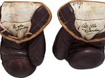 The 1971 Muhammad Ali gloves from his first Joe Frazier bout are pictured in this undated handout photo courtesy of Heritage Auctions received July 31, 2014.  The gloves that boxing legend Muhammad Ali wore in his legendary 1971 fight against Joe Frazier in what became known as the Fight of the Century will come up for auction on Thursday and are expected to fetch more than $300,000. REUTERS/Heritage Auctions/Handout via Reuters  (UNITED - Tags: ENTERTAINMENT SPORT BOXING) ATTENTION EDITORS - NO SALES. NO ARCHIVES. FOR EDITORIAL USE ONLY. NOT FOR SALE FOR MARKETING OR ADVERTISING CAMPAIGNS. THIS PICTURE WAS PROVIDED BY A THIRD PARTY. REUTERS IS UNABLE TO INDEPENDENTLY VERIFY THE AUTHENTICITY, CONTENT, LOCATION OR DATE OF THIS IMAGE. THIS PICTURE IS DISTRIBUTED EXACTLY AS RECEIVED BY REUTERS, AS A SERVICE TO CLIENTS