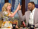 High five! But the pair's opening monologue was interrupted when ABC cut to a newsflash about the bombing of Iraq