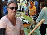 Get my suit right, or else! Mickey Rourke brandishes baseball bat while visiting his Beverly Hills tailor