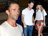 Newly married: Adam Levine and new wife Behati Prinsloo held hands as they stepped out for dinner on Wednesday in Los Angeles following their honeymoon