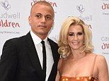 Couple: Sunderland defender Wes Brown's wife Leanne is still counting the pennies - as she proved during a recent trip to Legoland. Above, the couple are pictured at the Grosvenor House Hotel in London in May