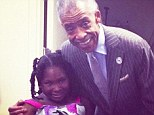 All smiles: The little girl with scars on her chest beamed and said she is 'feeling good' during the meeting in Harlem