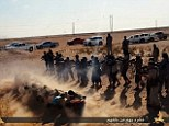 Barbaric: Around 20 Islamic State fighters stand behind the line of men and the squad of jihadists begin to gun down the prisoners