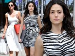 Contrasting: Emmy sported an angelic white dress as she grabbed food in Beverly Hills on Friday, left, before slipping into a zebra dress to film Shameless, right