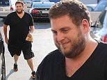 Jonah Hill dressed in a plain black t-shirt and shorts for a trip to the gym.  The actor stopped off for a snack after his workout, on Thursday, August 7, 2014 X17online.com  EXCLUSIVE