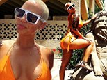 Amber Rose sticks out her curvaceous derriere in bright orange string bikini at beachy bachelorette bash