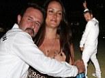 High spirits! Exuberant David Arquette makes fiancée Christina cringe by pulling embarrassing poses outside Rihanna & Eminem concert