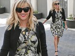 No wonder she's smiling! Reese Witherspoon has a spring in her step as she treats herself to a shopping spree at Prada following a trip to her office