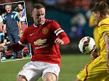 MIAMI GARDENS, FL - AUGUST 04:  Wayne Rooney of Manchester United in action with Steven Gerrard of Liverpool during the pre-season friendly match between Manchester United and Liverpool at Sun Life Stadium on August 4, 2014 in Miami Gardens, Florida.  (Photo by John Peters/Man Utd via Getty Images)
