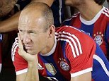 Bayern Munich's Arjen Robben of the Netherlands, foreground left,  waits besides his team mates for the start of an official photo shooting for the new German first division Bundesliga season in Munich, southern Germany, Saturday, Aug. 9, 2014. (AP Photo/Matthias Schrader)