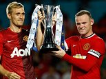 MIAMI GARDENS, FL - AUGUST 04:  (L) Darren Fletcher #24 of Manchester United and (R) Wayne Rooney #10 of Manchester United lift the winners trophy following their 3-1  victory over Liverpool in the Guinness International Champions Cup 2014 Final at Sun Life Stadium on August 4, 2014 in Miami Gardens, Florida.  (Photo by Chris Trotman/Getty Images)
