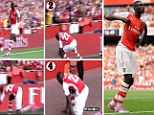 Down he goes: Yaya Sanogo fell over whilst celebrating his fourth goal against Benfica