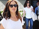 Minka Kelly is casual but chic in slim fitting denim and white T-shirt for grocery shopping trip
