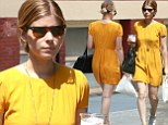 Sunshine: Kate Mara brightened up New York City in a vivid yellow romper as she strolled around on Friday