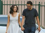Visiting hours? Emmy Rossum is elegant in white as she holds hands with boyfriend Sam Esmail on Shameless set