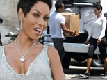 Moving on! Nicole Murphy dazzles in plunging dress after day spent packing up possessions following Michael Strahan split