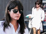 Letting loose! Selma Blair looks chic in casual white shirt dress and black sandals for gas station stop