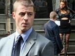 Benjamin McKenzie interrogates a leather clad prostitute in a scene from new Batman-themed TV series Gotham