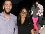 Geek chic: Jordana Brewster donned hipster-inspired glasses and slim red trousers for a date night with her husband Andrew Form at Mr. Chow in Beverly Hills, California on Saturday