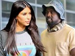 Here comes the family man! Kanye West looks happy to greet Kim and baby North during airport pick-up in San Francisco