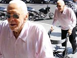 He still has a Lust For Life! Kirk Douglas, 97, does not let old age slow him down as he goes for stroller aided walk in Los Angeles