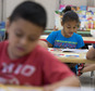 This photo taken July 21, 2014 shows students in Jane Cornell's summer school class learn story telling skills at Mary D. Lang Kindergarten Center in Kennett...