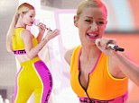 Fancy pants! Rapper Iggy Azalea flaunts her fabulous curves in a bright tangerine ensemble as she celebrates her life-changing summer anthem