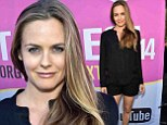 'Sometimes you have to show a little skin!' Alicia Silverstone reveals some serious leg on the red carpet