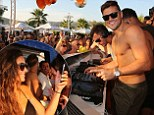 Michelle Keegan beams with pride as she watches Mark Wright spin tunes for the crowd as they party away in sunny Ibiza