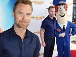 Where's his black and white cat? Ronan Keating and Postman Pat walk the red carpet for their Sydney premiere