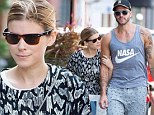 Shopping buddies: Kate Mara appeared to be in need of some fashion buying assistance while out shopping in Manhattan on Saturday, so the actress acquired help from celebrity stylist and former model Johnny Wujek