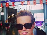 Hungover: Sam Armytage shares a picture of her in dark sunglasses showing she's back on the booze after Dry July as she jets off from Las Vegas on Sunday