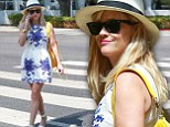 Strutting in style: Reese Witherspoon showed off her toned legs in a floral frock as she stopped by a nail salon in Brentwood, California on Friday