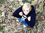 Couldn't find a toilet? Miley Cyrus pops a squat in the forest... and posts the picture on Instagram
