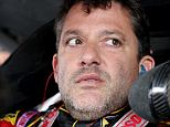 WATKINS GLEN, NY - AUGUST 08:  Tony Stewart, driver of the #14 Rush Truck Centers/Mobil 1 Chevrolet, sits in his car during practice for the NASCAR Sprint Cup Series Cheez-It 355 at Watkins Glen International on August 8, 2014 in Watkins Glen, New York.  (Photo by Jerry Markland/Getty Images)