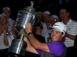 LOUISVILLE, KY - AUGUST 10:  Rory McIlroy of Northern Ireland celebrates with the Wanamaker trophy after his one-stroke victory during the final round of the 96th PGA Championship at Valhalla Golf Club on August 10, 2014 in Louisville, Kentucky.  (Photo by David Cannon/Getty Images)