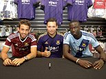Pic by Avril Husband / Griffiths Photographers West Ham players meet fans in the club shop in Romford. Cheikhou Kouyate, Mauro Zarate and Diego Poyet in attendance 07-08-2014 The players show off all 3 shirts
