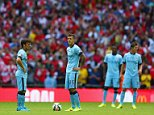 LONDON, ENGLAND - AUGUST 10:  David Silva of Manchester City and Stevan Jovetic of Manchester City prepare to restart after the third goal socred by Olivier Giroud of Arsenal during the FA Community Shield match between Manchester City and Arsenal at Wembley Stadium on August 10, 2014 in London, England.  (Photo by Michael Steele - The FA/The FA via Getty Images)