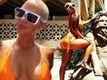 Amber Rose sticks out her curvaceous derriere in bright orange string bikini at beachy bachelorette bash