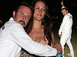 High spirits! Exuberant David Arquette makes fiancée Christina cringe by pulling embarrassing poses outside Rihanna & Eminem concert