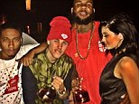 What will Kris Jenner think? Kylie poses with Justin Bieber and The Game as they hold BOTTLES of hard liquor during her 17th birthday bash