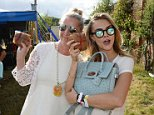 OXFORD, ENGLAND - AUGUST 09: Anne Marie Verdin (L) and Cara Delevingne attend The Mulberry Wilderness Picnic with Cara Delevingne during Wilderness 2014 at Cornbury Park on August 9, 2014 in Oxford, England.  Pic Credit: Dave Benett