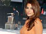Making room for the nursery? Pregnant Eva Mendes has removal men take out table and chairs from her Hollywood Hills mansion