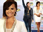 Night and day! Demi Lovato swaps demure white dress for leather glam-rock getup as she wins TWO Teen Choice Awards
