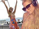 No wonder she is happy! Paris Hilton presses play and earns herself thousands of dollars a minute DJing in St. Tropez